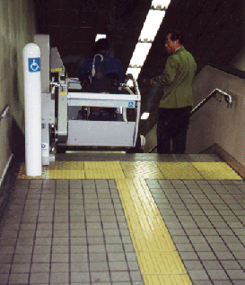 Stairs are often retrofitted with stair lifts in transit terminals, as here in a Tokyo subway station. However, in new construction, elevators should be considered where possible.
