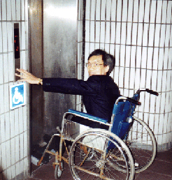 A wheelchair user takes the elevator from the platform level of the Shenzhen, China, railroad station.