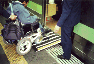 Small portable ramps can provide inexpensive access in many rail stations, as shown here in Tokyo.