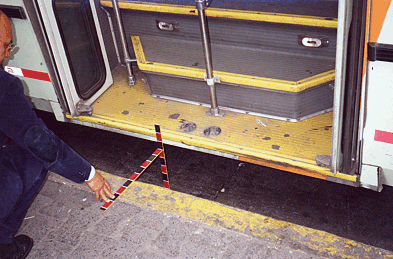 In other new buses in Mexico City, a wide rear door has low steps and is easily accessed by semi-ambulatory passengers from a raised sidewalk, but requires that drivers carefully pull in to the curb.<br>Photo by T. Rickert, courtesy of DFID (UK) and TRL (UK).