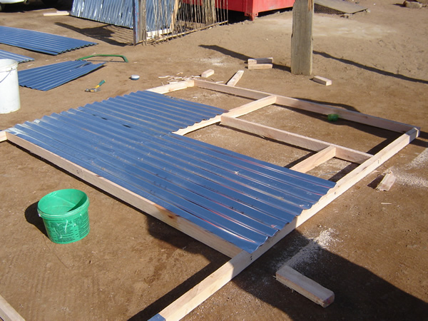 Local Resource and skills - use of sheet and timber to make house panel