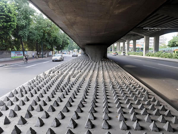 Concrete spikes under a bridge in Guangzhou City, China. Photo by Christopher Herring.